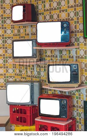 Many Retro Television On The Shelves And Boxes