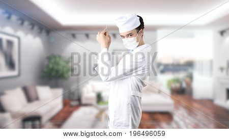 Beautiful Medical Woman Doctor In Uniform. Studio Painted Background. Concept Of Profitable Health C