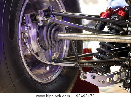 Front wheel of drive car with the new tire and Shock Absorber