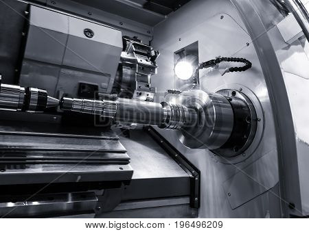 industrial metal work bore machining process by cutting tool on the automated lathe