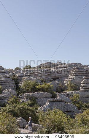 Antequera Spain - July 14 2017: elderly woman walking by Torcal Natural Park Malaga Spain