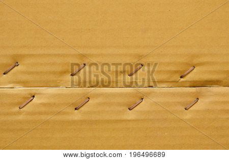 brown hard paper box with metal wire tacked background and texture