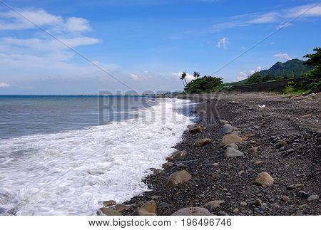 Rugged coastline with rocks and surf in southern Taiwan