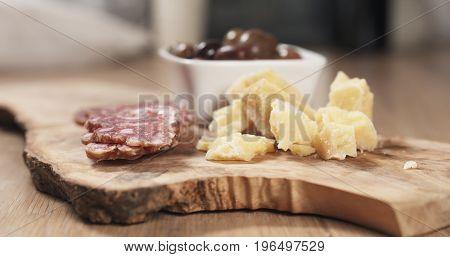italian antipasti appetizers on olive board, wide photo