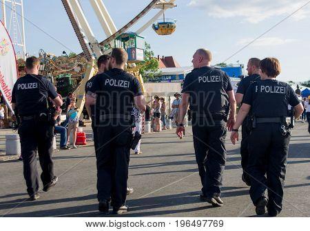 Rüsselsheim, Germany - June 12 2017: German Police officers on duty at Hessentag in Rüsselsheim, Germany