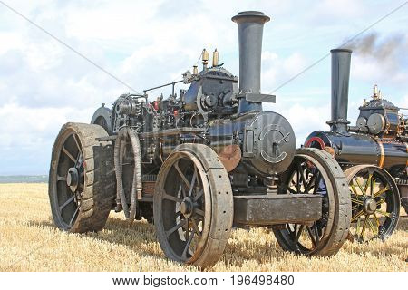 Steam traction engine standing in a field