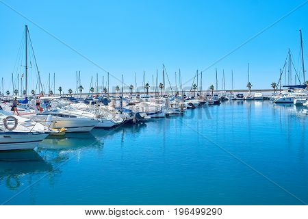 Sailboat harbor, beautiful moored sail yachts in the seaport, summertime vacation, luxury lifestyle concept