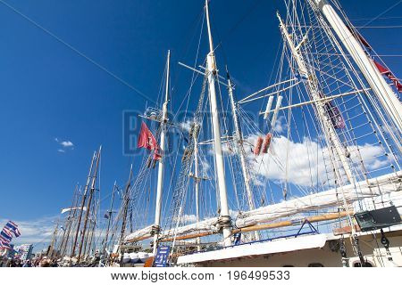 THE TALL SHIPS RACES KOTKA 2017. Kotka, Finland 16.07.2017. Masts of sailboat at the blue sky background.