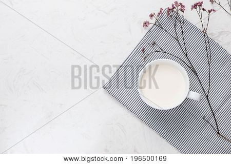 Dairy products. Top view of a cup of milk on a table.