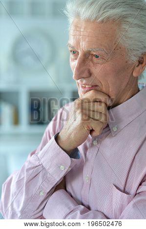 Close up portrait of smiling senior man