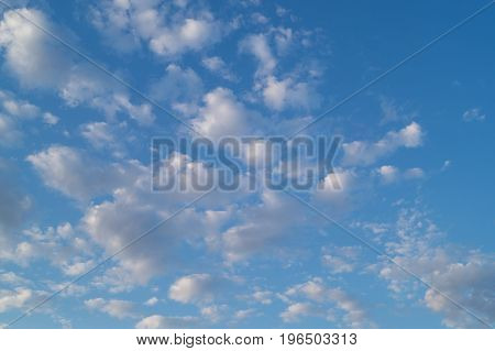 Fkuffy small cumulus clouds on the sky