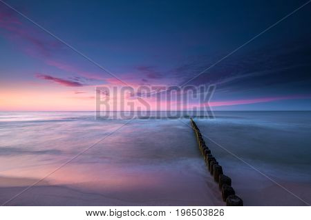 Colorful sky at sunset over the Baltic Sea. Long exposure