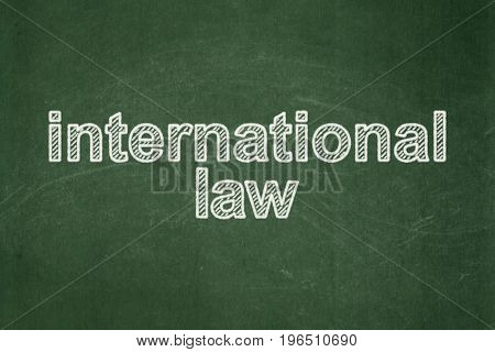 Politics concept: text International Law on Green chalkboard background