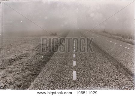 Old Black And White Photo Of Countryside Road In Dense Mist.