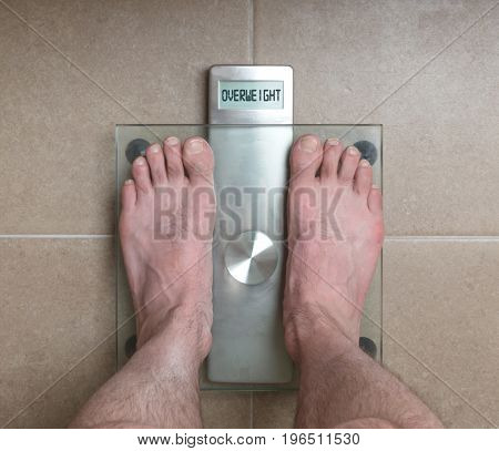 Man's Feet On Weight Scale - Overweight