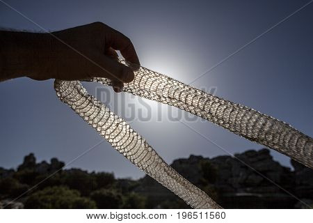 Hand holding old snake skin against the light. Torcal de Antequera National Park Malaga Spain