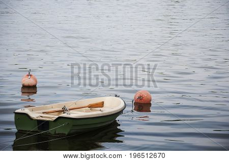 a boat with paddles moored on the lake