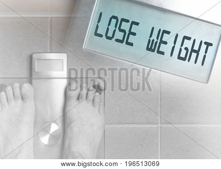 Man's Feet On Weight Scale - Lose Weight