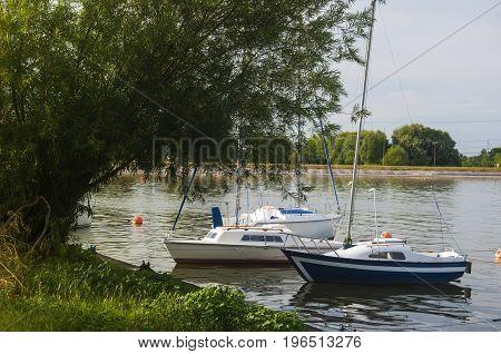 sailboats floating on lake over the coast