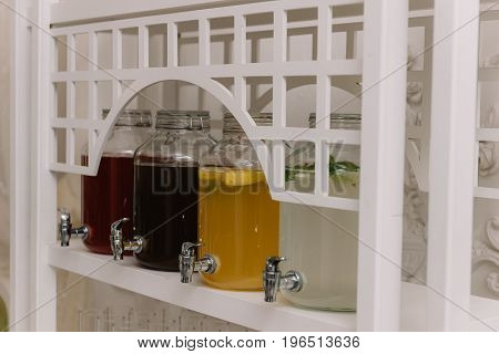 Bar with lemonades and cold drinks for the guests on the wedding