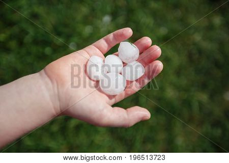 Large hail on the child's palm after hailstorm in Vienna, Austria.