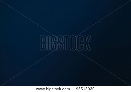 Colored background with a shade of color ranging from blue to black. Ideal for graphic designs and to be used as background.