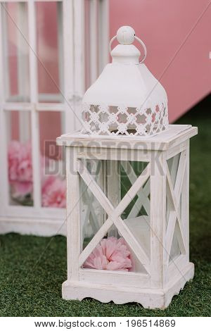 White street light with candle and flower as a wedding decoration