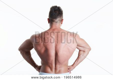 Young sexy muscular man posing in studio background