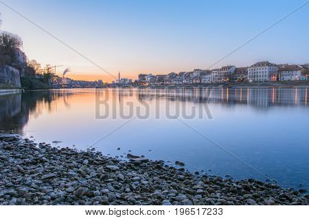 Beautiful City on river with sunrise in summer - Skyline of Basel in Switzerland