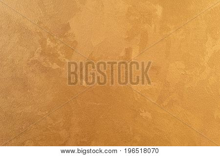Gold decorative plaster of walls, internal furnish. Textured background. Top view.