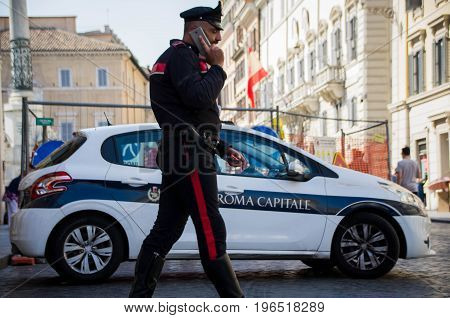 Rome, Italy - June 15 2017: Carabinieri military officer on duty in Spanish Steps in Rome, Italy