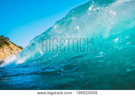 Blue wave in sea. Clear wave and sun light