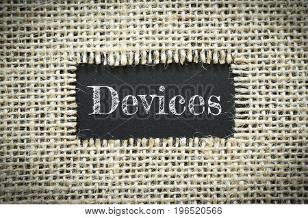 Text Devices on paper black has Cotton yarn background you can apply to your product.