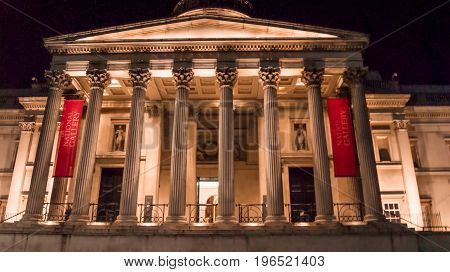 London UK - February 23 2016: The National Gallery in Londonin Trafalgar Square at dusk. The National Gallery houses one of the greatest collections of paintings in the world. Enjoy free entrance 361 days a year.