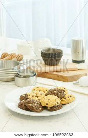 Bakery Tools, Ingredients And Cookies On Counter Top In Kitchen