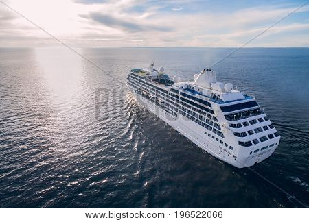 Aerial view of cruise liner sailing in the open sea at sunset