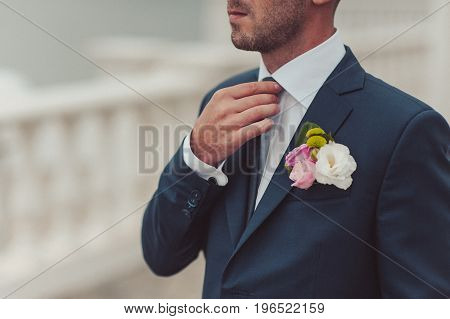 Wedding Boutonniere With Natural Flowers On A Jacket