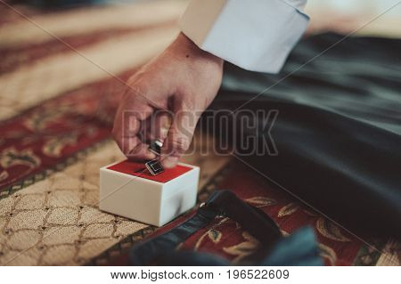 The Groom Fastens The Cufflink On The Shirt Sleeve Close-up