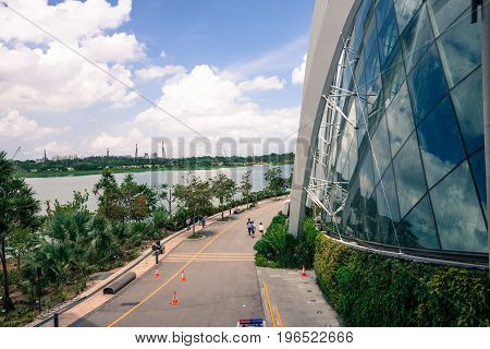 SINGAPORE - MARCH 22 2017: Street beside Flower Dome tourist attraction at Gardens by the Bay in Singapore.