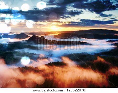 Film Effect.  Red Daybreak. Misty Daybreak In A Beautiful Hills. Peaks Of Hills Are Sticking Out Fro