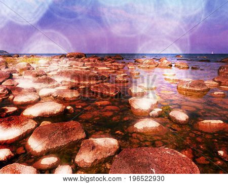 Film Effect. Big Boulders In Shore In  Smooth Wavy Sea. Stony Coastline, Clear Sky.