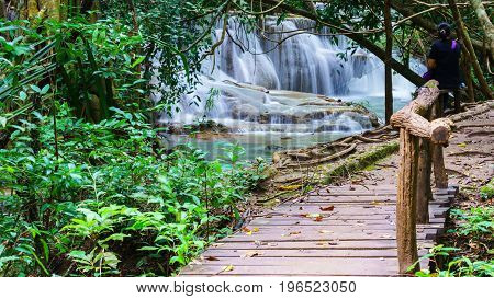 Wooden walkway leading to viewpoint tier 6 at Huay Mae Khamin Waterfalls is located in Khuean Srinagarindra National Park north of Kanchanaburi The seven-tiered waterfalls Thailand