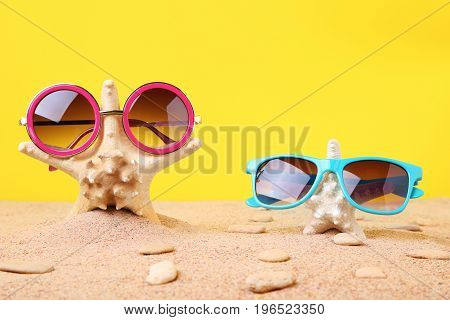 Sunglasses With Starfish On The Beach Sand
