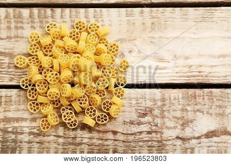 Heap Of Pasta On The Brown Wooden Table