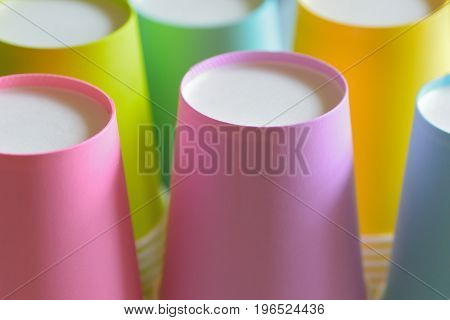 Macro details of lined up colorful paper cups in horizontal frame