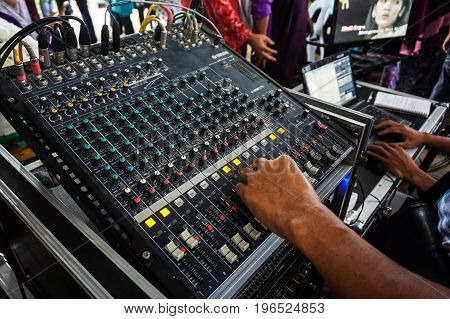 Keningau,Sabah-July 30,2017:View of hand adjusting audio mixer to monitor sound quality during wedding ceremony party in Keningau,Sabah,Malaysia.