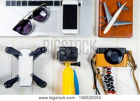 Summer travel fashion and objects on white wooden background