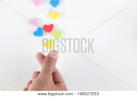 Colorful hearts sending out from hand on white background love concept