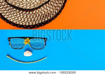 Sunglasses And Hats On Colorful Blue And Orange Paper