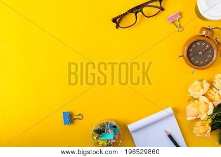 Office Equipment On A Yellow And Golden Paper Desk